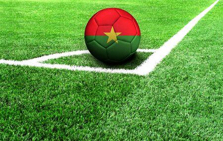 soccer ball on a green field, flag of Burkina Faso