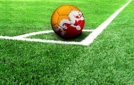 soccer ball on a green field, flag of Butane