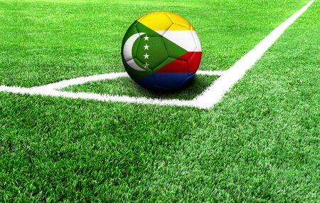 soccer ball on a green field, flag of Comoros