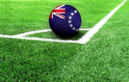soccer ball on a green field, flag of Cook Islands