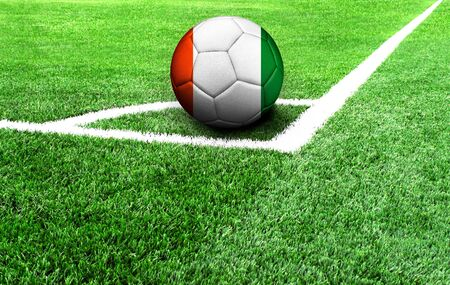 soccer ball on a green field, flag of Cote d,lvoire