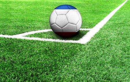 soccer ball on a green field, flag of Crimea