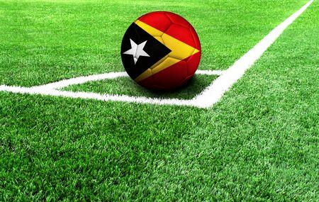 soccer ball on a green field, flag of East Timor