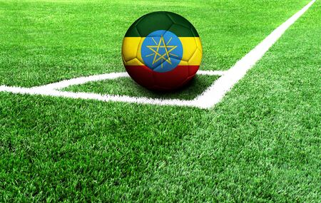 soccer ball on a green field, flag of Ethiopia