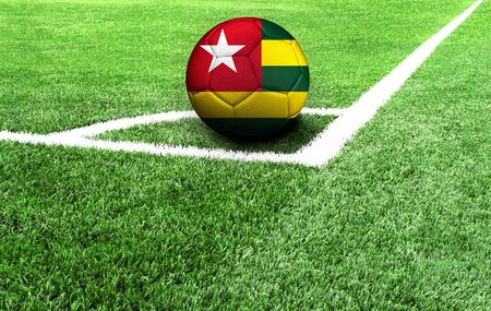 soccer ball on a green field, flag of Togo