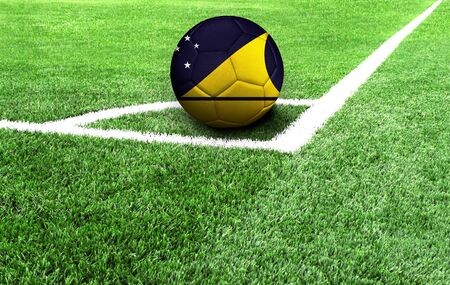 soccer ball on a green field, flag of Tokelau