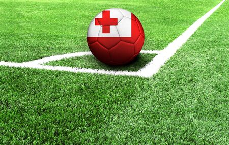 soccer ball on a green field, flag of Tonga