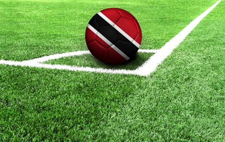 soccer ball on a green field, flag of Trinidad and Tobago