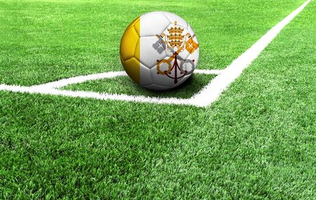 soccer ball on a green field, flag of Vatican city Holy see