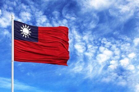 National flag of Taiwan on a flagpole in front of blue sky