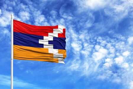 National flag of Nagorno Karabakh Republic on a flagpole in front of blue sky 版權商用圖片