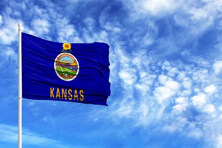 National flag State of Kansas on a flagpole in front of blue sky 版權商用圖片