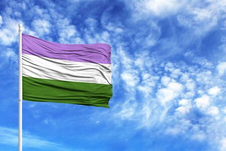 National flag genderqueer pride on a flagpole in front of blue sky