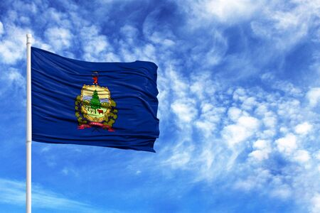 National flag State of Vermont on a flagpole in front of blue sky 版權商用圖片