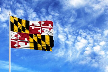 National flag State of Maryland on a flagpole in front of blue sky