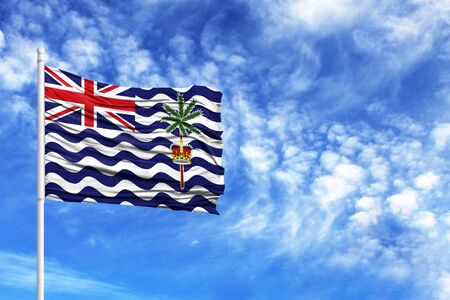 National flag of British Territory in the Indian Ocean on a flagpole in front of blue sky