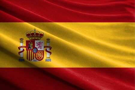 Realistic flag of Spain on the wavy surface of fabric Stockfoto
