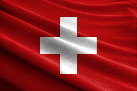 Realistic flag of Switzerland on the wavy surface of fabric Stockfoto