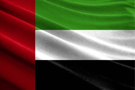 Realistic flag of United Arab Emirates on the wavy surface of fabric Stockfoto