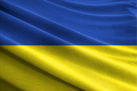 Realistic flag of Ukraine on the wavy surface of fabric