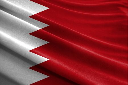 Realistic flag of Bahrain on the wavy surface of fabric