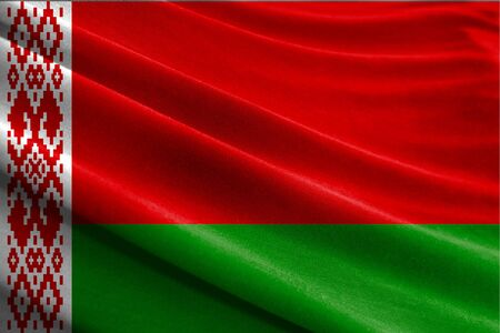 Realistic flag of Belarus on the wavy surface of fabric Stockfoto