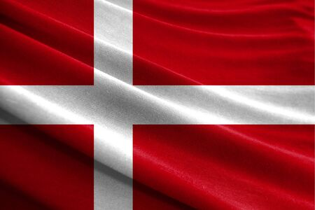 Realistic flag of Denmark on the wavy surface of fabric Stockfoto