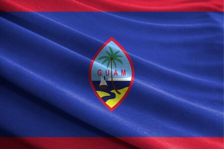 Realistic flag of Guam on the wavy surface of fabric