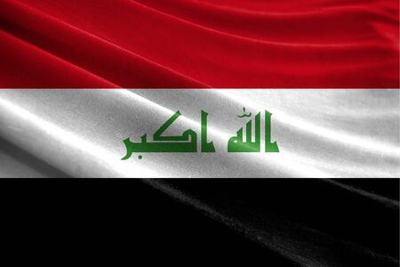 Realistic flag of Iraq on the wavy surface of fabric