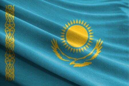 Realistic flag of Kazakhstan on the wavy surface of fabric