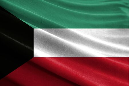 Realistic flag of Kuwait on the wavy surface of fabric