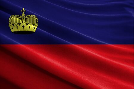 Realistic flag of Liechtenstein on the wavy surface of fabric