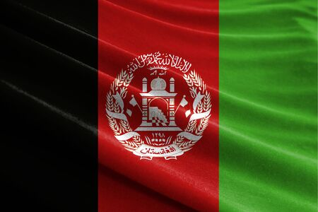 Realistic flag of Afghanistan on the wavy surface of fabric Stockfoto
