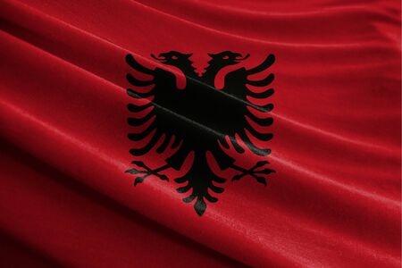 Realistic flag of Albania on the wavy surface of fabric Stockfoto