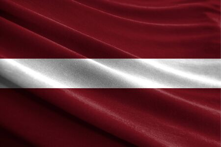 Realistic flag of Latvia on the wavy surface of fabric