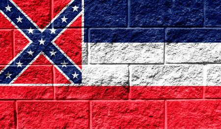 Flag State of Mississippi close up painted on a cracked wall
