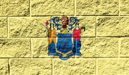 Flag State of New Jersey close up painted on a cracked wall Reklamní fotografie