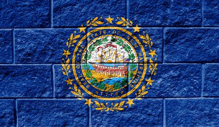 Flag State of New Hampshire close up painted on a cracked wall
