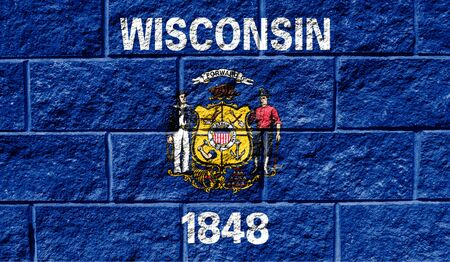 Flag State of Wisconsin close up painted on a cracked wall Reklamní fotografie