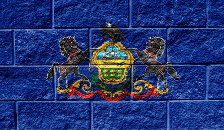 Flag State of Pennsylvania close up painted on a cracked wall
