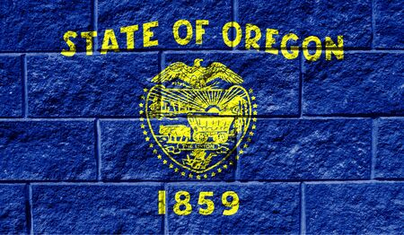 Flag State of Oregon close up painted on a cracked wall 写真素材
