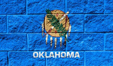 Flag State of Oklahoma close up painted on a cracked wall Reklamní fotografie