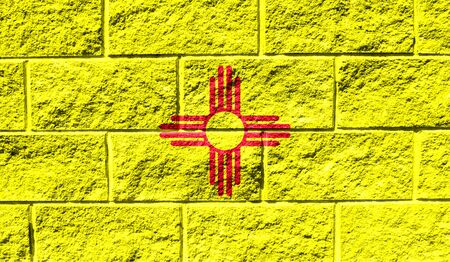 Flag State of New Mexico close up painted on a cracked wall
