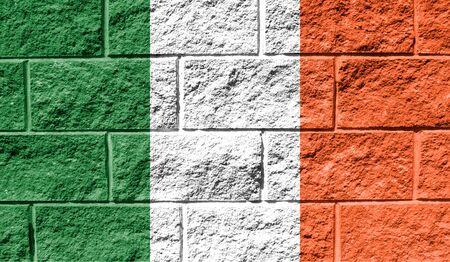 Flag of Ireland close up painted on a cracked wall