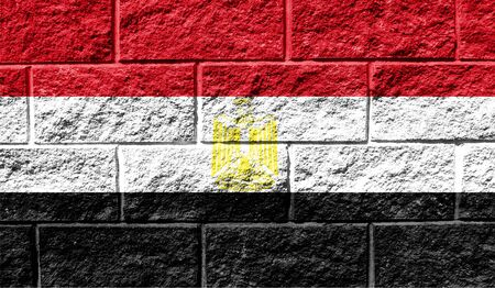 Flag of Egypt close up painted on a cracked wall