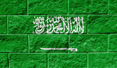 Flag of Saudi Arabia close up painted on a cracked wall