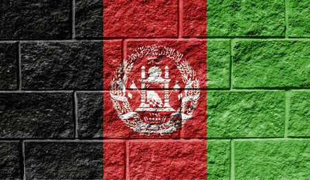 Flag of Afghanistan close up painted on a cracked wall Stock fotó