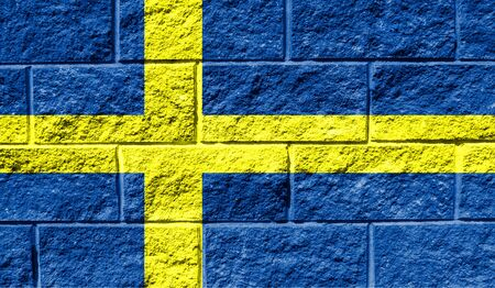 Flag of Sweden close up painted on a cracked wall