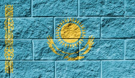 Flag of Kazakhstan close up painted on a cracked wall