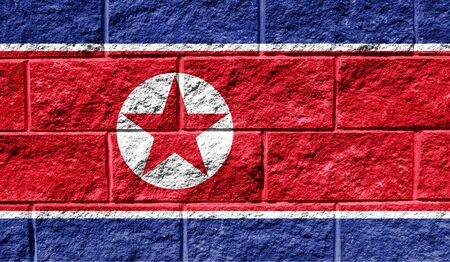 Flag of North Korea close up painted on a cracked wall